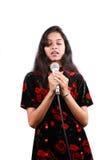 Singing a Prayer. A beautiful Indian teenage girl singing a prayer, on white studio background Stock Photos