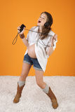Singing Pregnant Woman Stock Images
