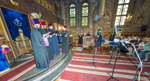 Singing priests in the Church of the Transfiguration of the Lord, Bulgarian Pomorie. Pomorie - famous resort town in Bulgaria. In summer it is a popular tourist stock photos