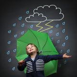 Singing in the rain. Young happy child singing and dancing holding an umbrella standing in front of a chalk drawing of a rain and lightning storm on a school vector illustration