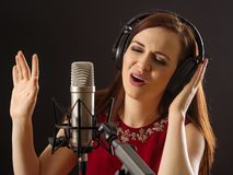 Singing in the recording studio royalty free stock photos