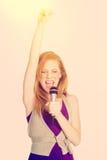 Singing Redhead Woman royalty free stock image