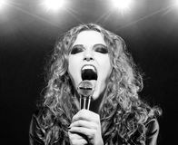 Singing rock song Stock Images