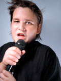 Singing sensation. Young teenage singer Royalty Free Stock Image