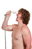 Singing in The Shower. Young man performing a concert by singing in the shower Stock Photos