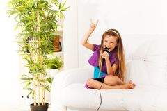 Singing and showing sign of horns Royalty Free Stock Photography