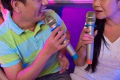 Singing a song. Close-up image of couple singing a song Stock Images
