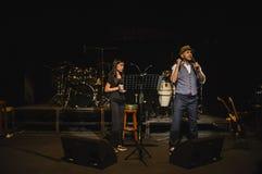 Singing on stage in dark studio stock photos