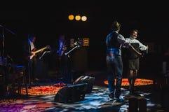 Singing on stage in dark studio Stock Images