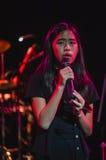 Singing on stage in dark studio Stock Image