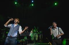 Singing on stage in dark studio Royalty Free Stock Image