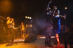 Singing on stage in dark studio Royalty Free Stock Photo