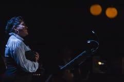 Singing on stage in dark studio Stock Photography