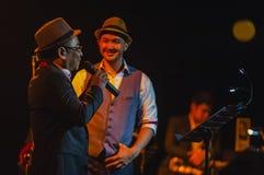 Singing on stage in dark studio Royalty Free Stock Photos