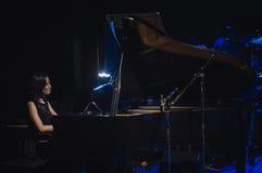 Singing on stage in dark studio Stock Photo