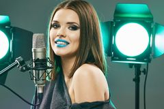 Singing star. Woman singer portrait. Sound studio stock photos