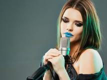 Singing star. Woman singer portrait. Sound studio royalty free stock image