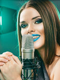 Singing star. Woman singer portrait. Stock Photo