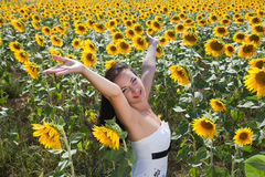 Singing in a sunflower field Royalty Free Stock Photography