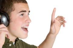Singing Teen Boy. Happy teen boy singing music stock photo
