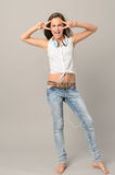 Singing teenager girl dancing full length Stock Image