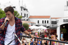 Singing on Top of Open Bus, Streets Full of People - David Carreira. August 2015, singer and actor David Carreira singing during his last concert from Cornetto stock photo