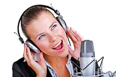 Singing woman in front of a microphone headset Royalty Free Stock Images
