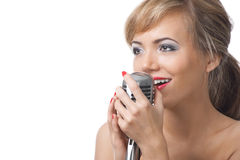 Singing woman with microphone Stock Images