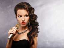 Singing Woman with Microphone.Glamour Singer Girl Portrait.  Karaoke Song Stock Image