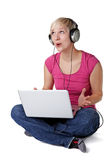 Singing woman with notebook and headphones Royalty Free Stock Photo