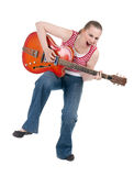 Singing woman playing on electric guitar Stock Images