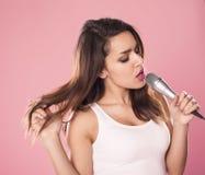Singing woman. Stock Photos