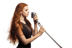 Singing Woman with Retro Microphone. Royalty Free Stock Images