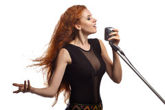 Singing woman with retro microphone. Stock Photos
