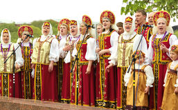 Singing women in Russian clothes stock photo