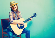 Singing young model play acoustic guitar. Royalty Free Stock Images