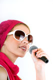 Singing young woman Royalty Free Stock Images