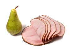 Singlde pear and smoked meat slices. Isoladed on the white background Royalty Free Stock Image
