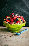 Single acai bowl of cereal and fruit on old table royalty free stock images