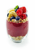 Single acai dessert glass of berries and oats Stock Photos