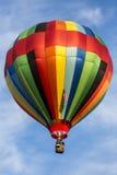 Single air balloon against a blue sky Stock Photos