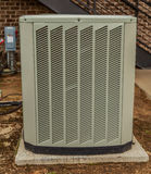 Single Air Conditioning Unit. A modern central air conditioning cooling outside compressor Royalty Free Stock Images