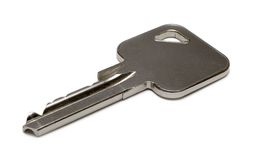 Single Apartment Key. Simply a key against white Stock Images