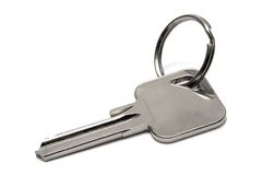 Single Apartment Key w/ Ring. Key with ring against white Stock Image
