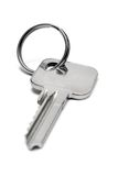 Single Apartment Key w/ Ring (Front View). Key with ring against white Stock Photography