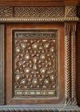 Single arabesque sash of an old mamluk era style cupboard with geometrical decorations stock images