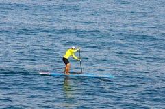 Single athlete rowing at Mediterranean Sea Stock Photo