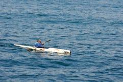 Single athlete rowing at Mediterranean Sea Royalty Free Stock Image