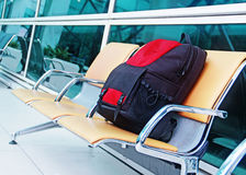 Single backpack at the airport stock photo