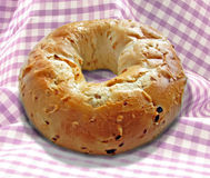 Single bagle on gingham tablecloth Royalty Free Stock Photography